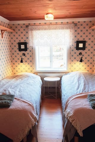 One of two smaller bedrooms