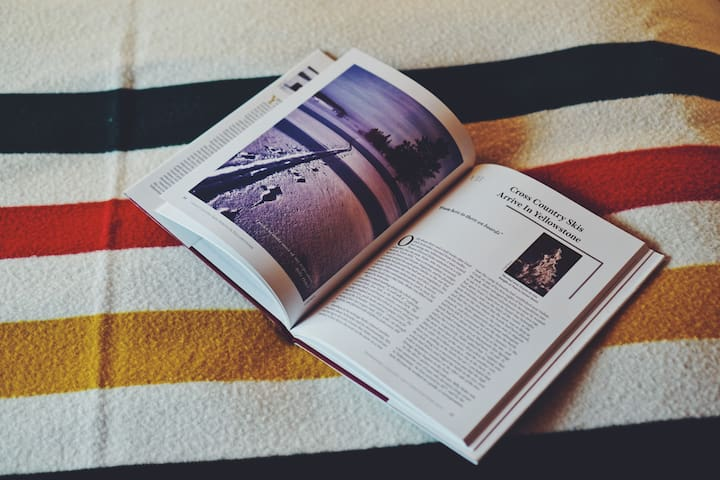 Grab one of many unique books of the area in the Bungalow and read while enjoying the warmth of a Pendleton Blanket