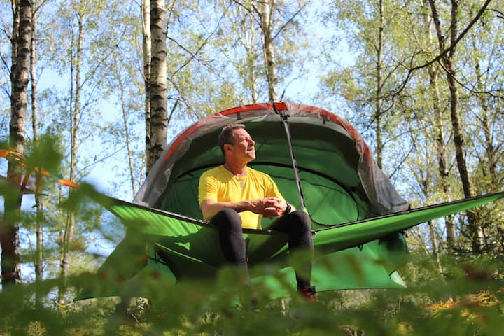 Adventurous airborne sleep in a tensile tree tent