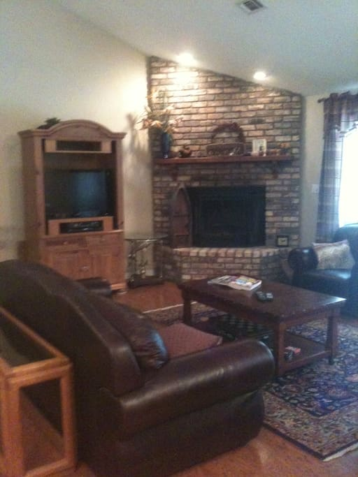Roomy and open family room with fireplace.