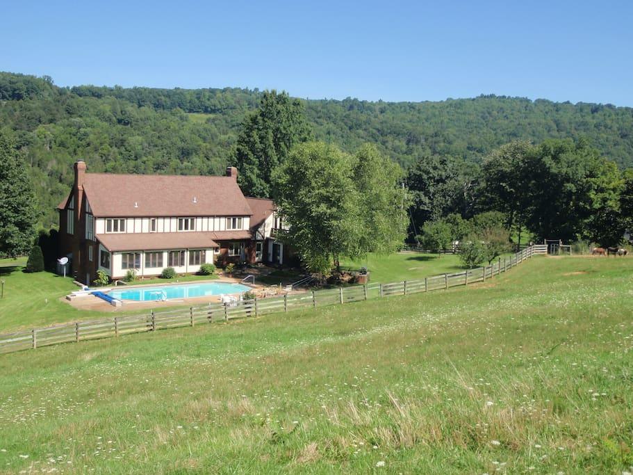 Back field and Farmhouse at Honey Creek Farm