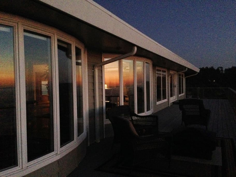 Beautiful Pacific Ocean Sunset reflecting off the many deck windows