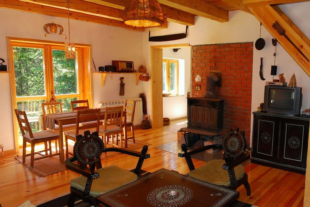 Living room with dining area, log burner, kitchen entrance