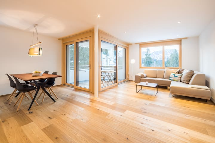 Brand new 2BR apartment right next to the valley station in Laax (Casa Val Mulin)