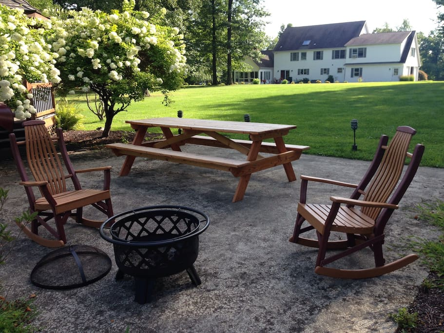 Picnic table, chairs, and a fire pit behind the gazebo. Perfect for backyard dinners or s'mores