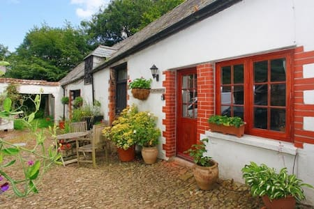 COACHMANS COTTAGE |  situated through an archway in a cobbled courtyard.