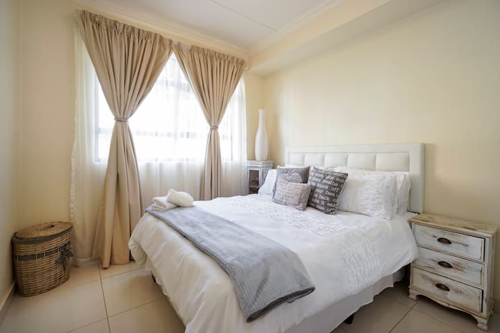 Main bedroom with a quality queen sized bed