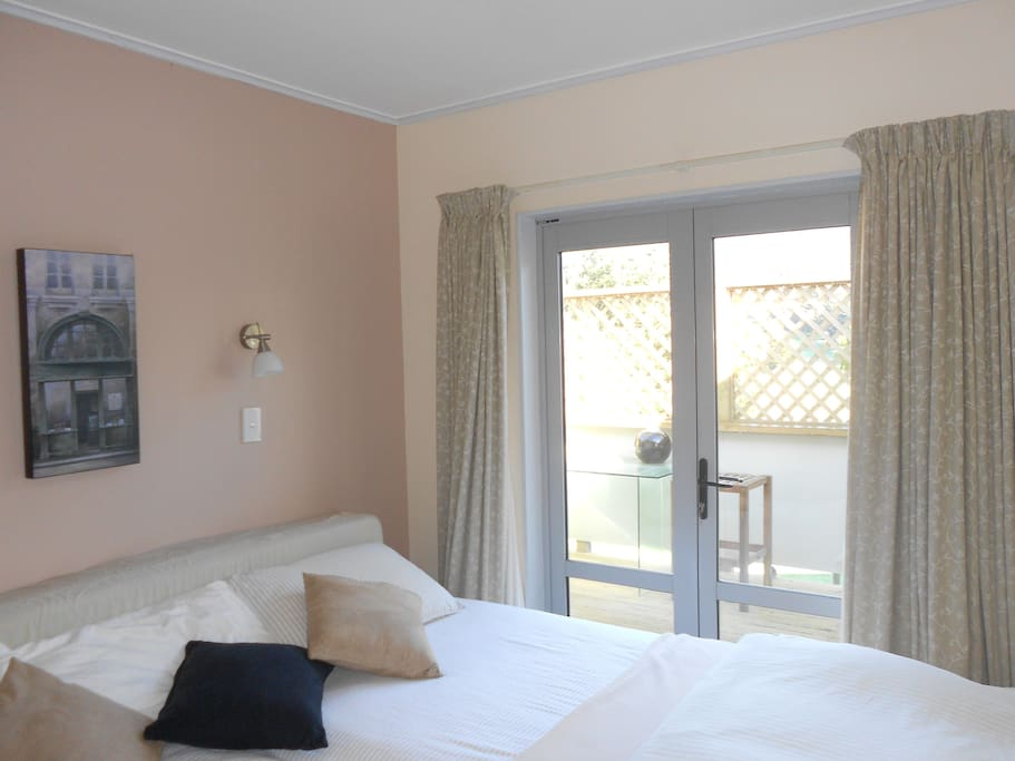 Sunny and warm bedroom, two king single beds