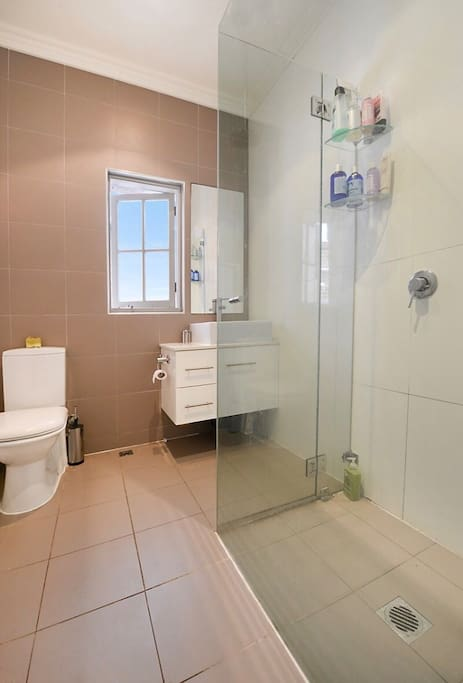 Bathroom with adjoining laundry facilities.