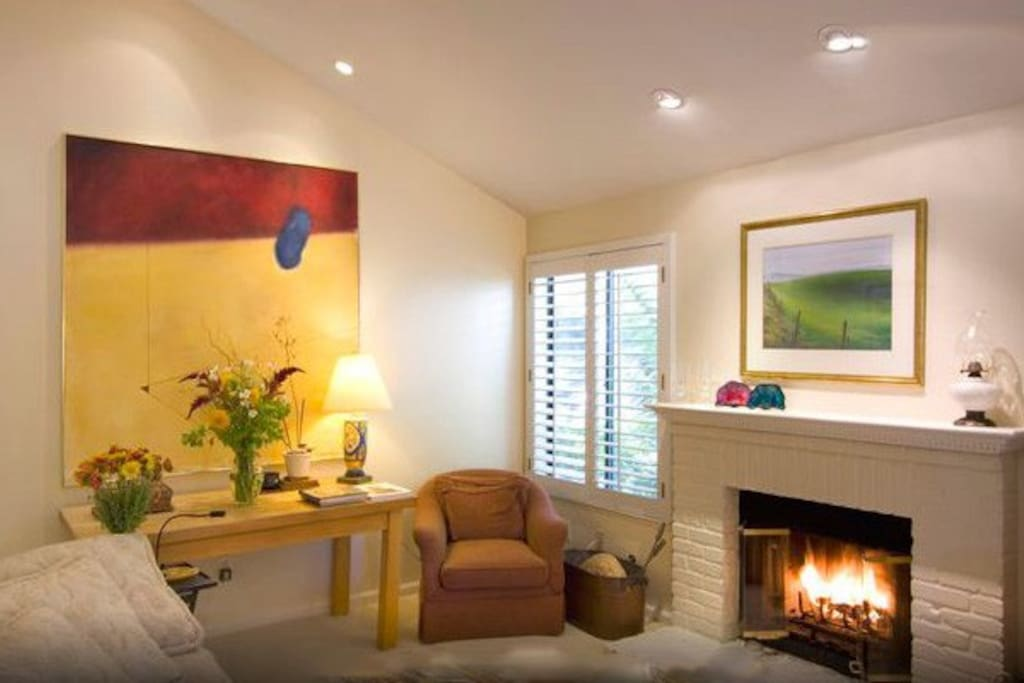 Relax in front of the family room's gas/wood burning fireplace, no matter the season!  Extensive collection of original art displayed throughout the home.
