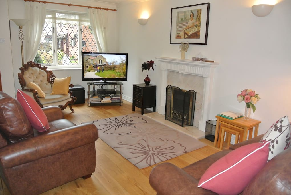 Spacious lounge with 42 inch TV and Blue Ray/ DVD player. New real wood floor. New leather sofa and chair and tables for 2017.