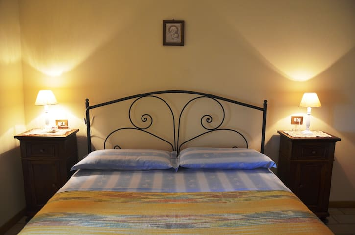 Double bedroom with antiques and wrought iron bed