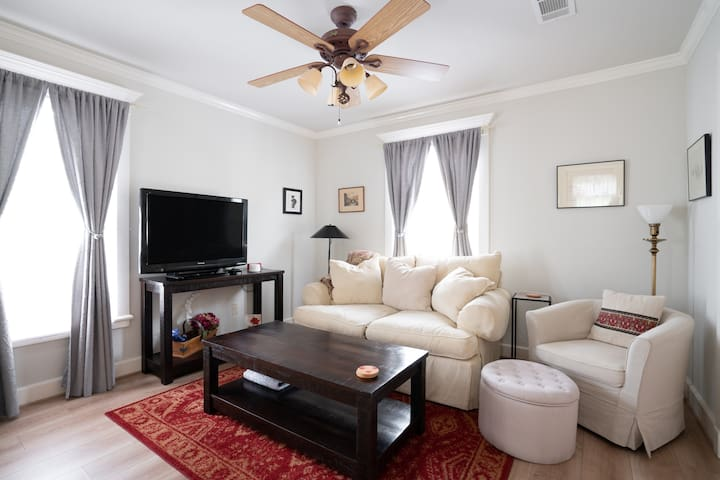 A comfortable space to relax and catch up on TV and movies. Guests chilled by the AC can snuggle with a homemade quilt or warm blanket. The curtains can be drawn to darken the room.