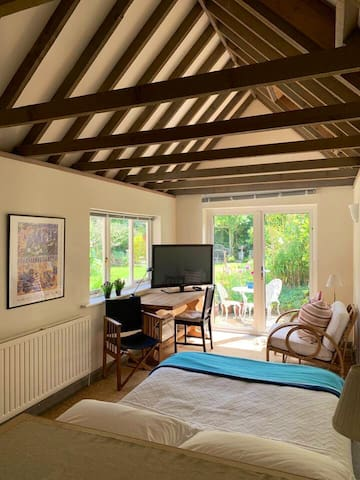 Lovely bright studio space looking onto the garden