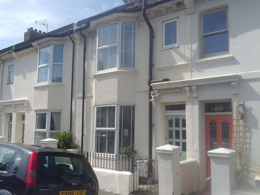 Front of house easily recognised green door and black railings.