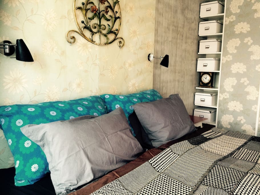 King Size Bed with 2 new matresses 90 x 200 middle soft, placed on comodes where we leave our belongings, while you live in our home. Small Private Balcony from the bedroom, big triple window with shades and courtains.