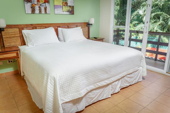 Second bedroom with balcony overlooking backyard - King or 2 Twin XLs (currently showing King)