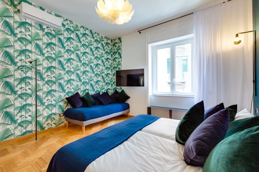 """the """"Palms"""" room when a king size bedroom and 49'' samsung smart tv"""