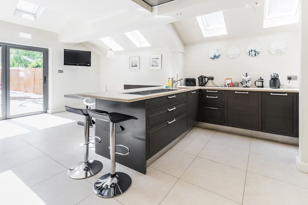 The living room with a bright kitchen area!
