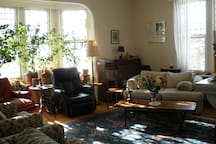 Living room; comfortable chairs; pianos; bookcases