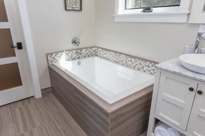 Relax in the soaking tub in the bright master bathroom.