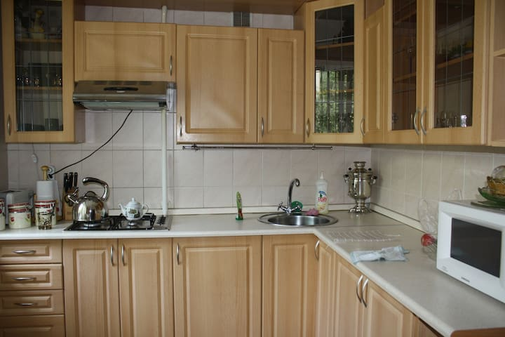 This fully fitted open-plan kitchen presents Oven, Fridge-freezer and all cooking utensil. Moreover, cooking essential such as sugar,salt, spices, tea are at your disposal.