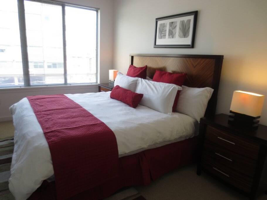 Master bedroom with en-suite bathroom, queen size bed and walk-in closet