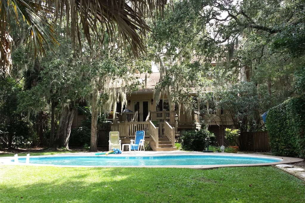 Backyard view of pool area and one of several majestic Spanish oaks.