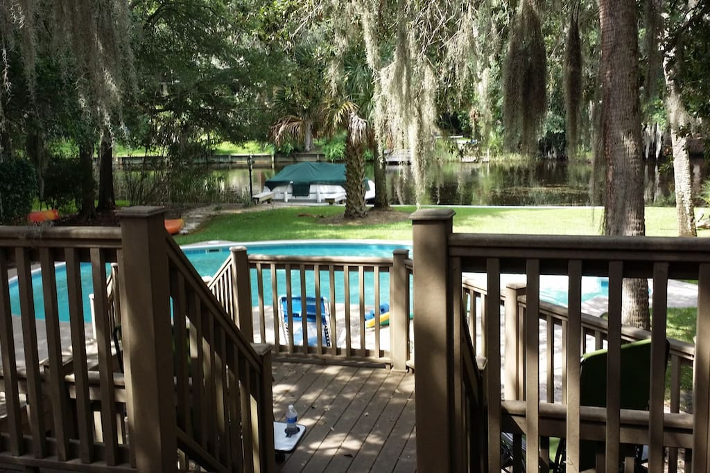 Back decks overlooking pool, dock and lagoon