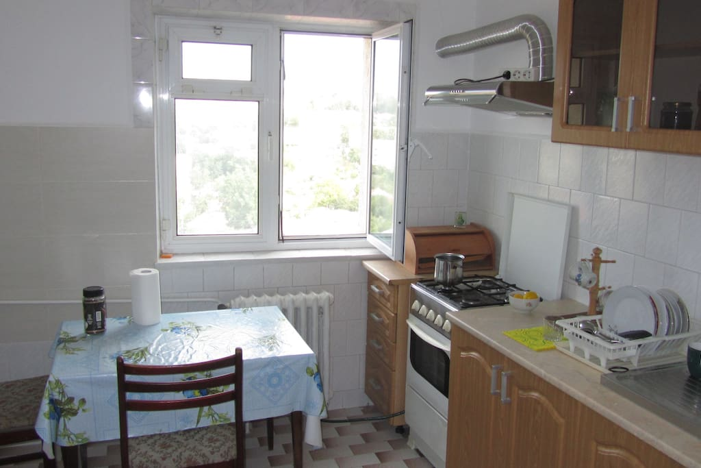 Kitchen has a cooking machine, fridge and washing machine.