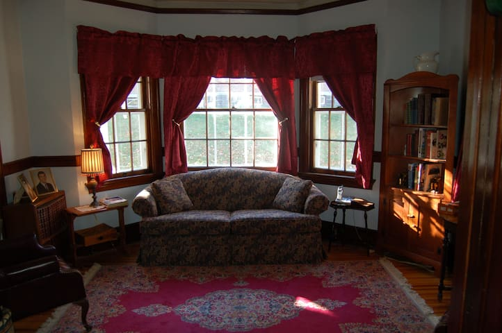Sitting Room with full size sleeper sofa and pocket doors