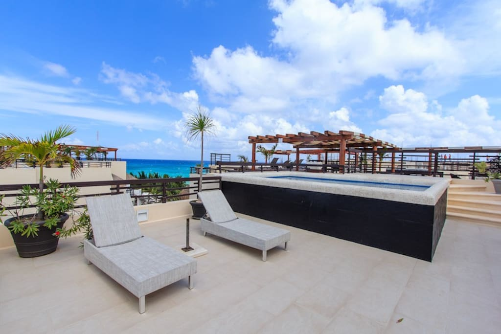 Ruff top terrace with lounge chairs and amazing Ocean views