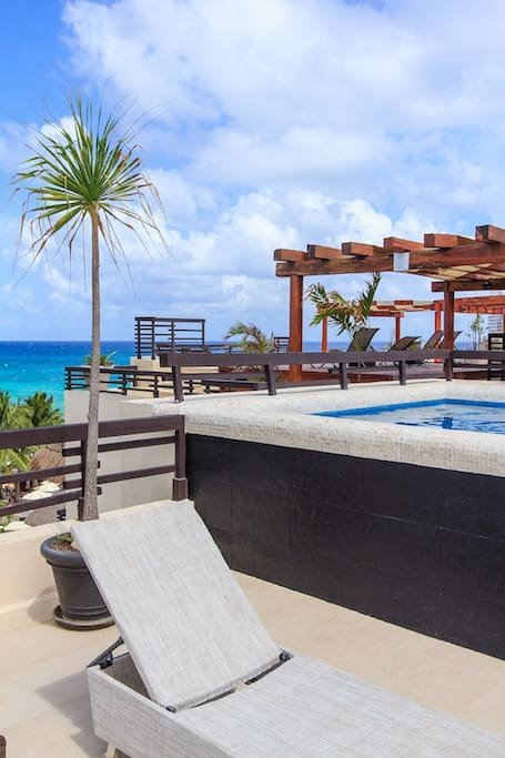 Relax in the pool while looking at the Ocean