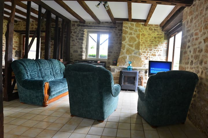Spacious lounge area with wood fire for the winter nights, TV English and French channels