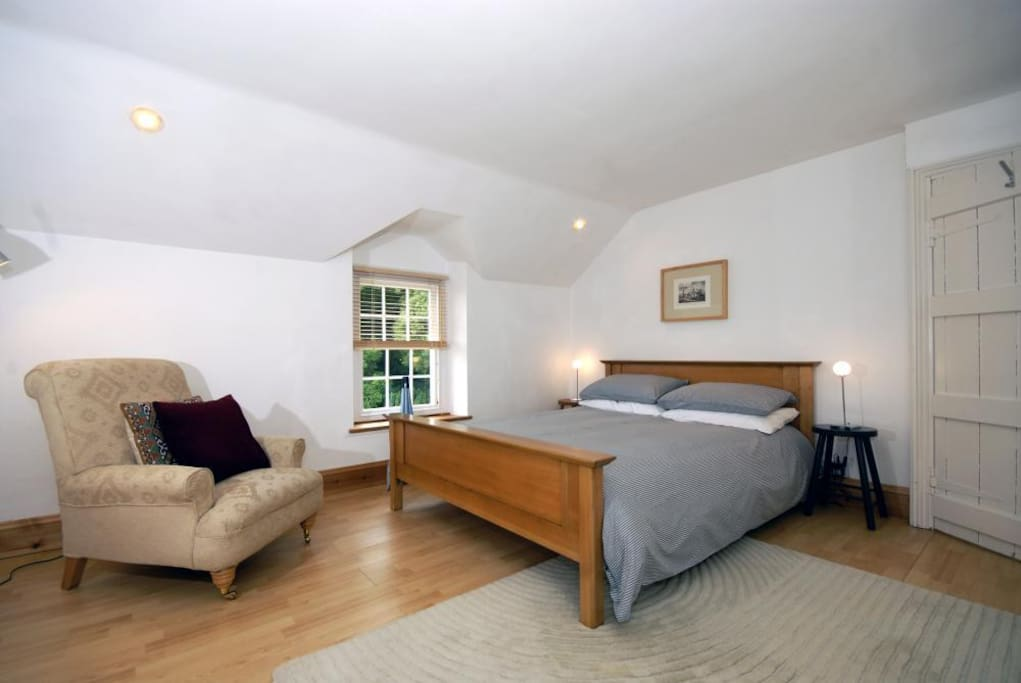 Spacious double bedroom with views over the fields & woodland