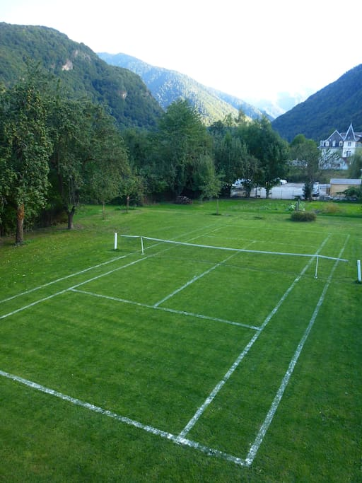 You are welcome to use this tennis court in the garden.