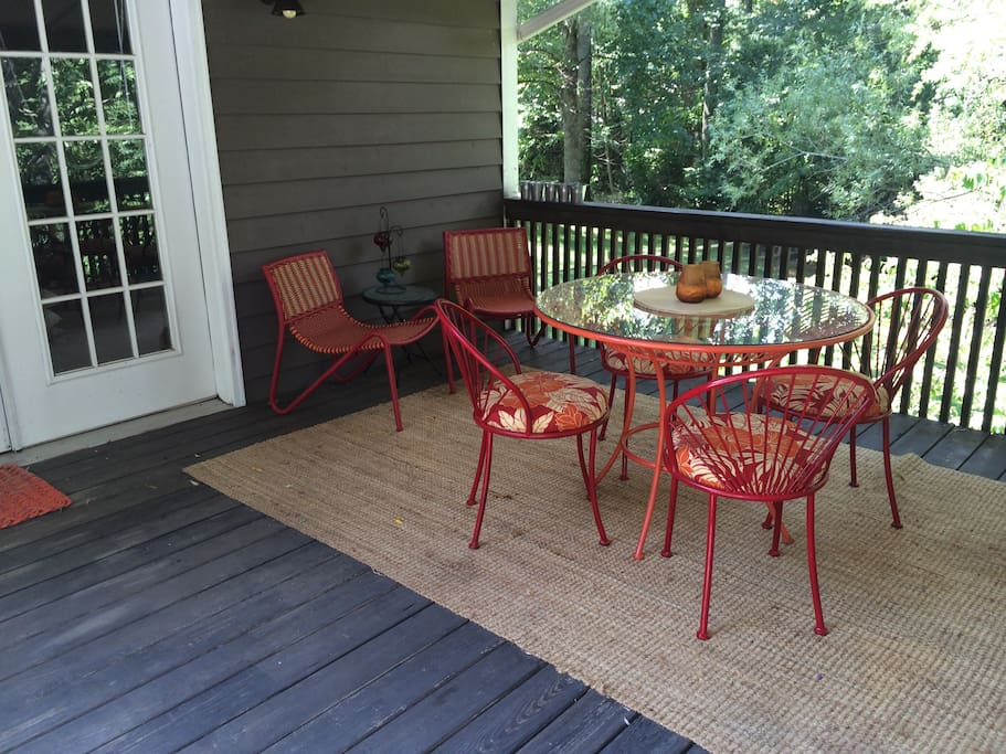 A lovely space on the deck to dine and relax, listen to the creek and the sounds of nature