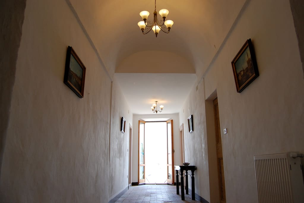 The beautiful long corridor to the balcony from the street.