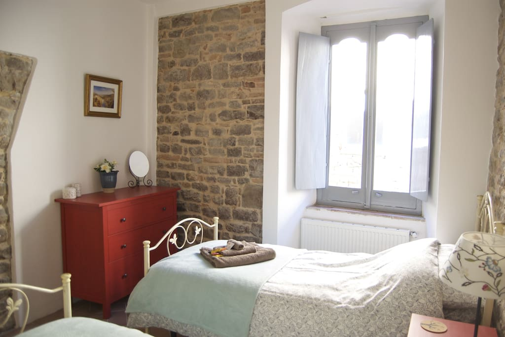 A beautiful twin room overlooking the medieval cobbled street.