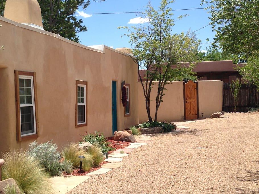 View toward #3 casita (blue door) next to private patio with hot tub (wooden door)
