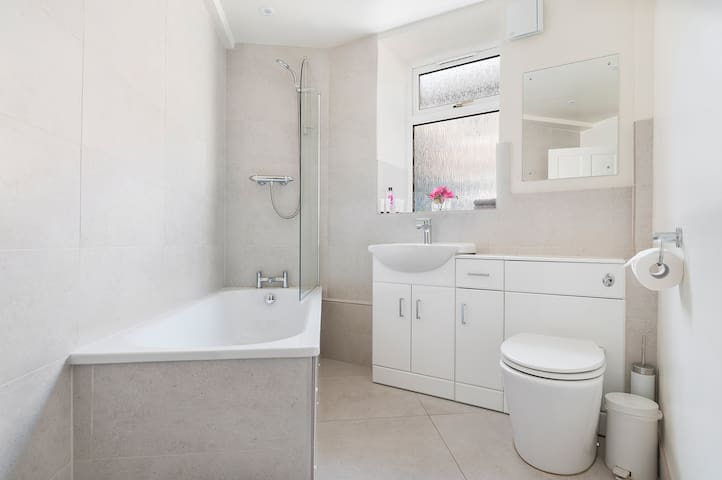 Bathroom with bath, power shower, toilet, underfloor heating and heated towel rail.  The bathroom is directly opposite the first bedroom.
