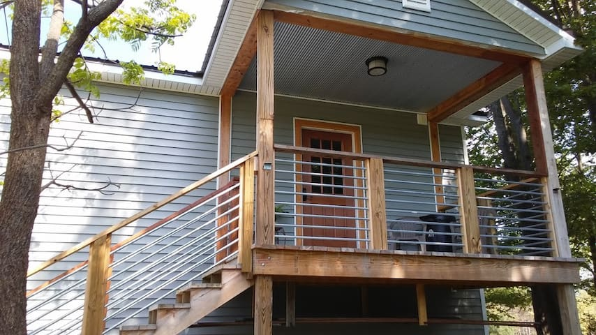 deck with dining area, great view of woods