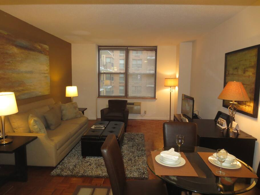 Spacious living room with dining area seating four where you can dine in comfort