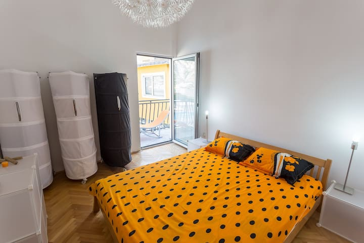 Bright colours of walls and glass doors are can be found in one of the rooms, so the guests who enjoy such spaces can pick this room.
