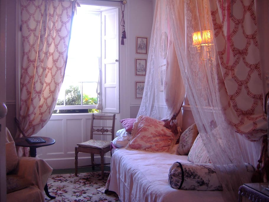 The Grey Room. One of the elegant canopy bedrooms, especially for singles.