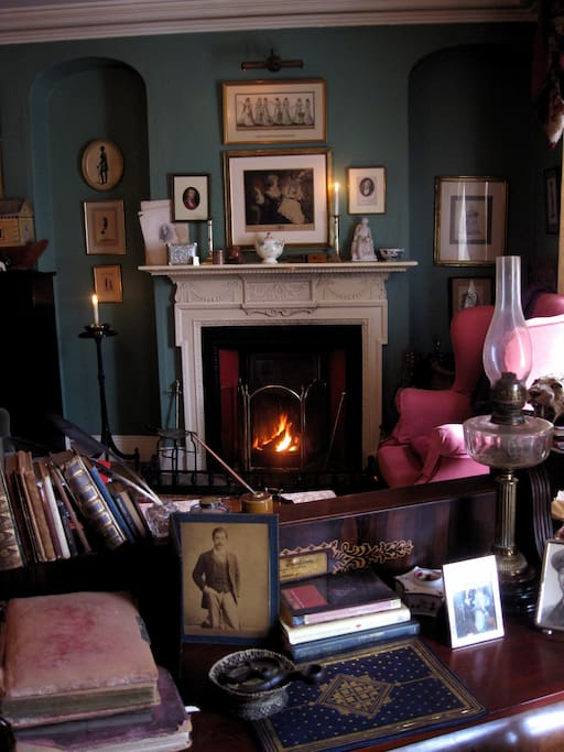 The Drawing Room, with an open fireplace and candlelit. This room has an old family piano which guests are most welcome to play. Lots of books here and in each of the rooms but there is also a broad selection of DVDs and videos for idling hours - from Hol