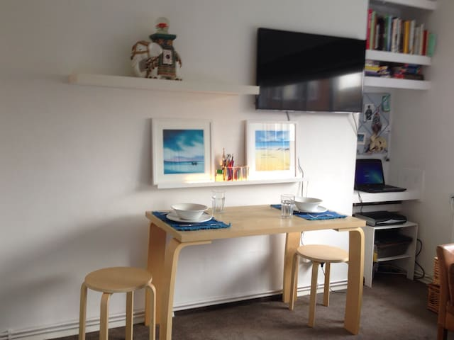 Study space, with a fast internet connection and a smart TV with sky TV & dining table with settings for 4 people.