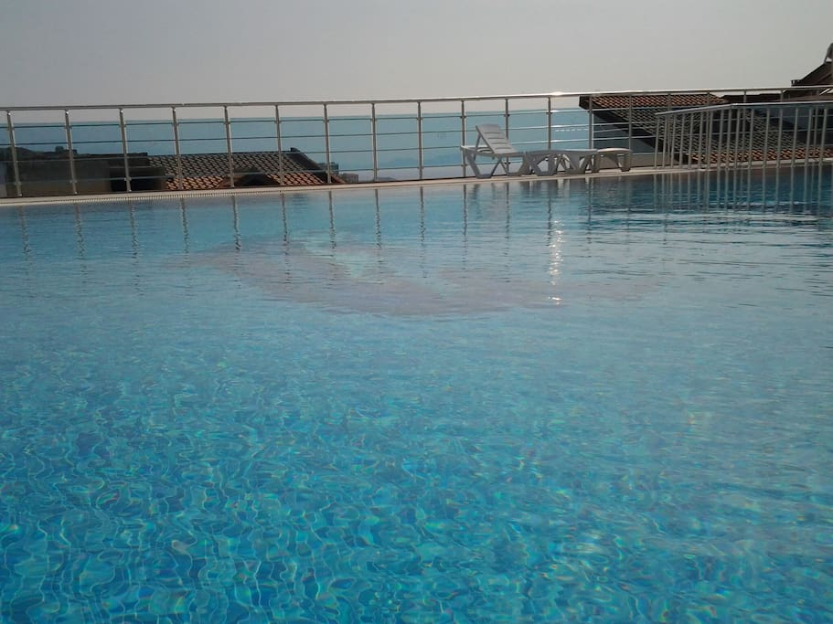 A big beautiful swimming pool with breathtaking views. There is also a secure children's pool.