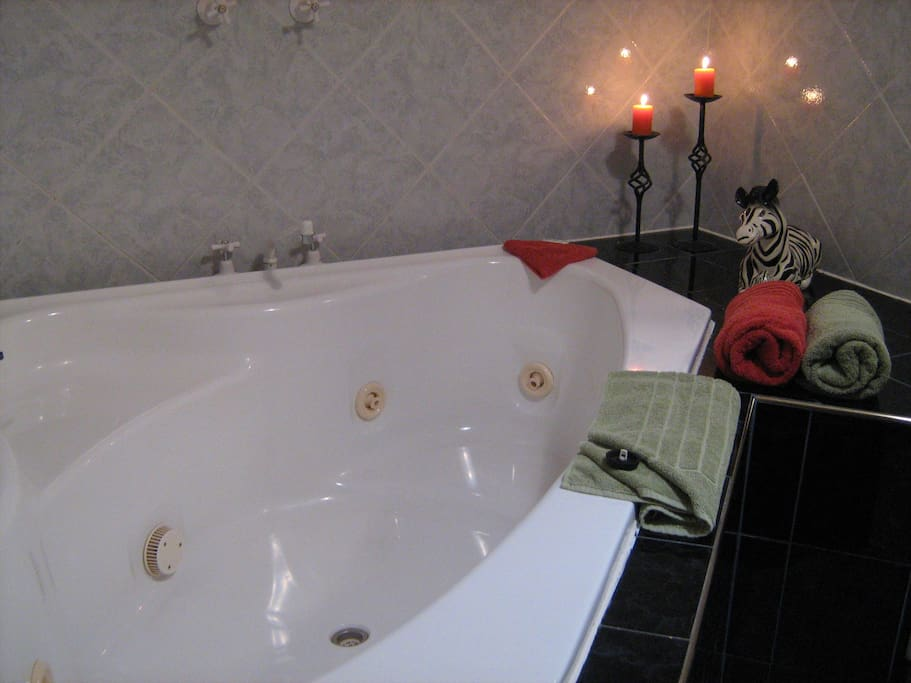 Private double spa bath in ensuite for ultimate relaxation.