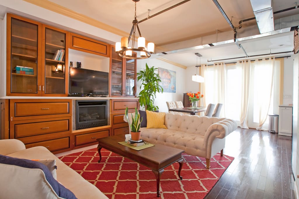 Built-in bookshelves and gas fireplace in open plan great room